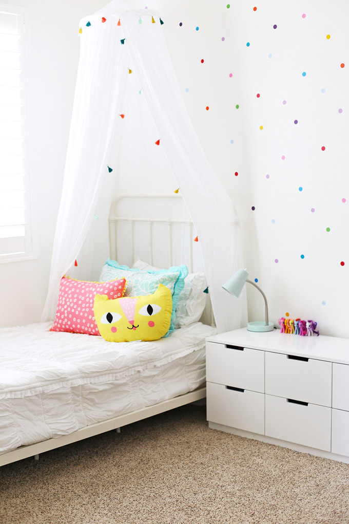 Unique Confetti Polka Dot Walls and Bright pops of color make this such a happy little girl us