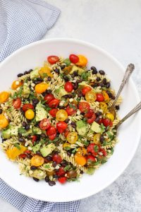 Vegan Taco Pasta Salad - This gluten free pasta salad is LOADED with color and flavor. Love the chili lime vinaigrette!