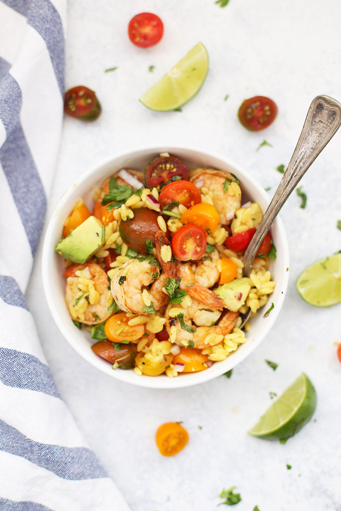 Cilantro Shrimp and Avocado Salad - This easy shrimp salad is SO delicious! The flavor is amazing. Make it with orzo, pasta, quinoa, or leafy greens! (Gluten free, paleo friendly)