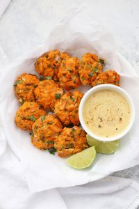 Chipotle Sweet Potato Salmon Cakes - These paleo salmon cakes are LOADED with flavor. Don't skip the chipotle dipping sauce. So good!