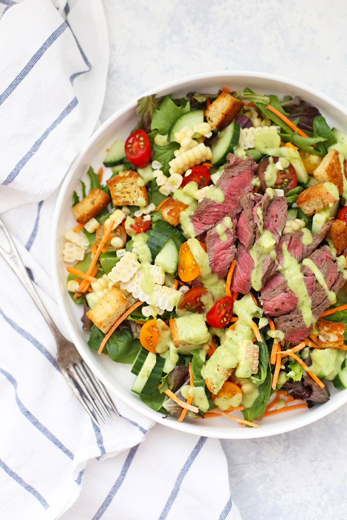 The star of this gorgeous salad is totally the avocado green goddess dressing. It's bright, tangy, and LOADED with flavor. Serve over steak, chicken, shrimp, and more! (Gluten free, dairy free)