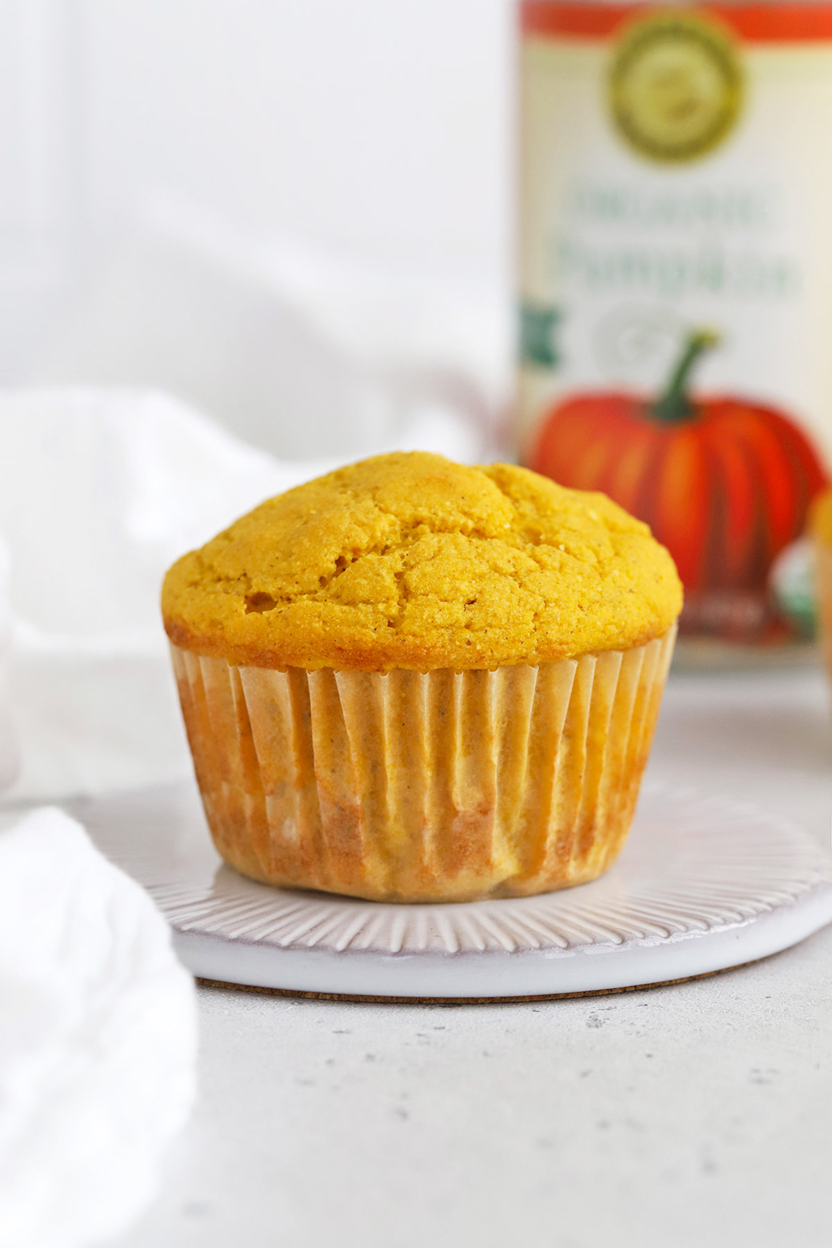 Front view of a gluten-free pumpkin cornbread muffin fresh from the oven