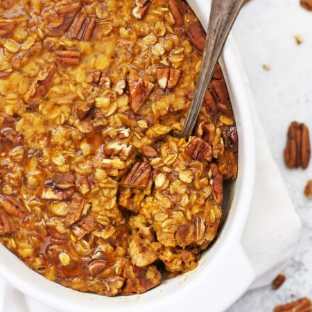 Baked Pumpkin Oatmeal - Studded with pecans and laced with the perfect blend of warm spices, this gluten free vegan breakfast is a fall favorite!