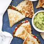 We LOVE these Loaded Vegan Quesadillas! So many goodies inside, you don't even miss the cheese!