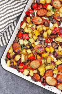 Sheet Pan Sausage and Veggies - This quick one pan dinner is always a big hit! Make it with your favorite sausage and veggie combinations to change up the flavor! (Gluten free, paleo, whole30 friendly!)