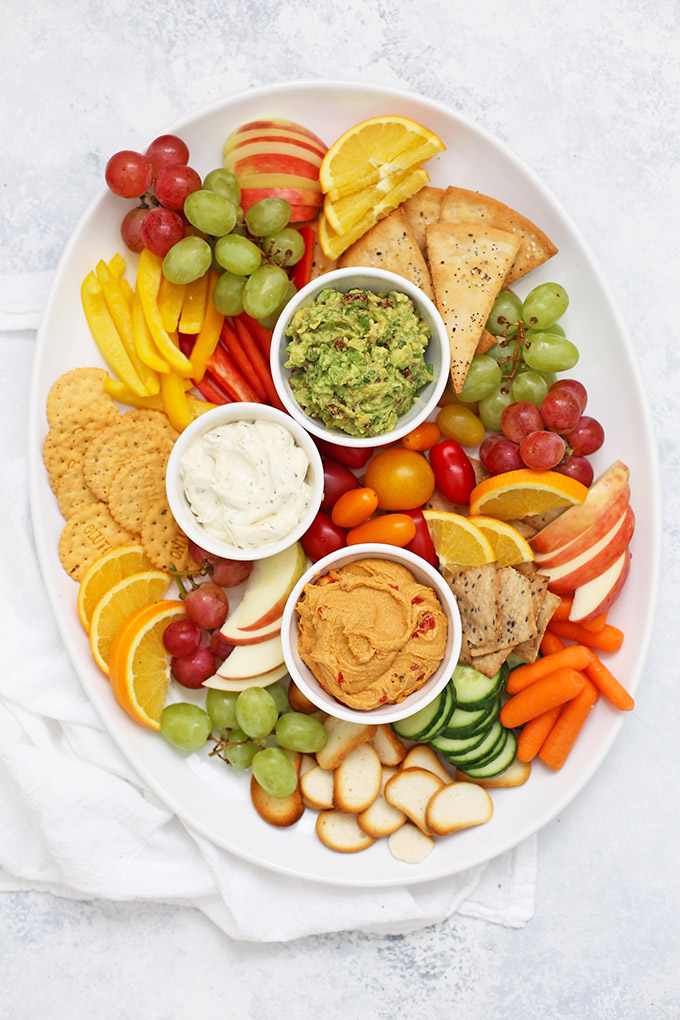 How to Make a Healthy Snack Board - An awesome hostess trick! (Plus, an amazing sun dried tomato avocado dip with gluten free flatbread crackers!)