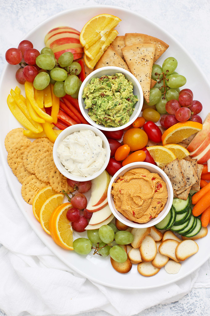 How to Make a Healthy Snack Board - You've GOT to try this Sun Dried Tomato Avocado Dip. Like the best guacamole ever!