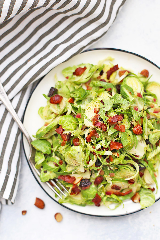 Bacon Brussels Sprouts Salad with Cherries and Almonds - This bright dressing will keep you coming back for more! (Paleo, gluten free, whole30 friendly)