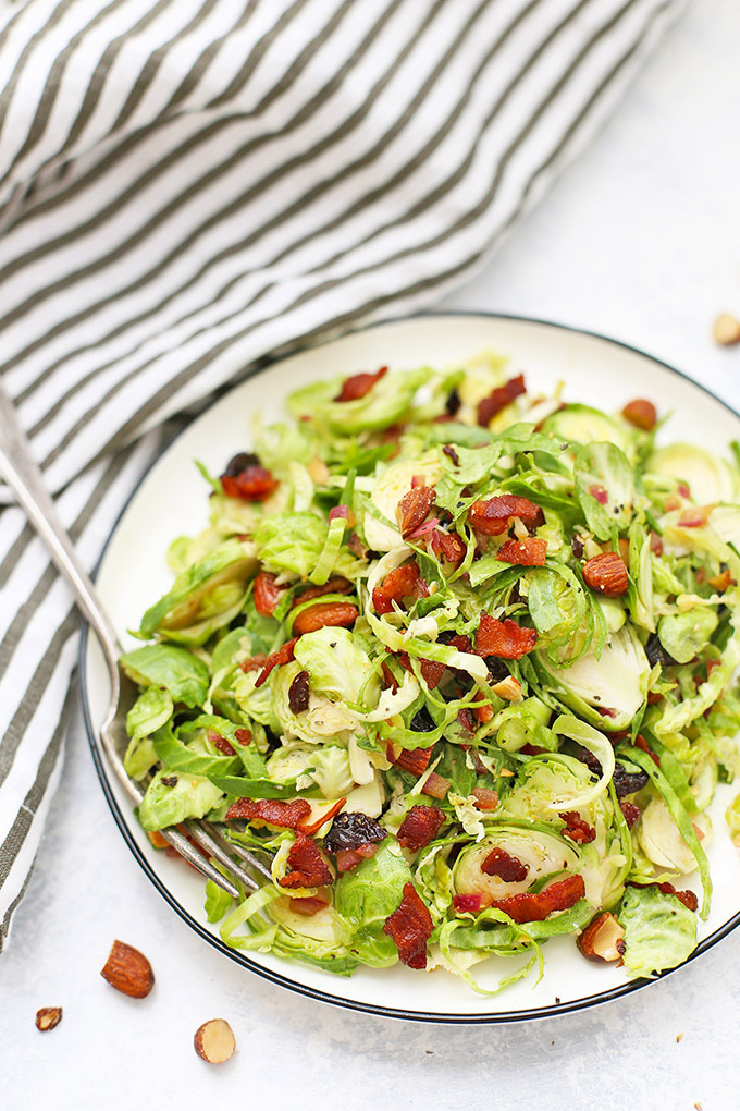 Bacon Brussels Sprouts Salad - This salad has a warm bacon dressing, dried cherries, almonds, and more! (Gluten free, paleo, whole30 friendly)