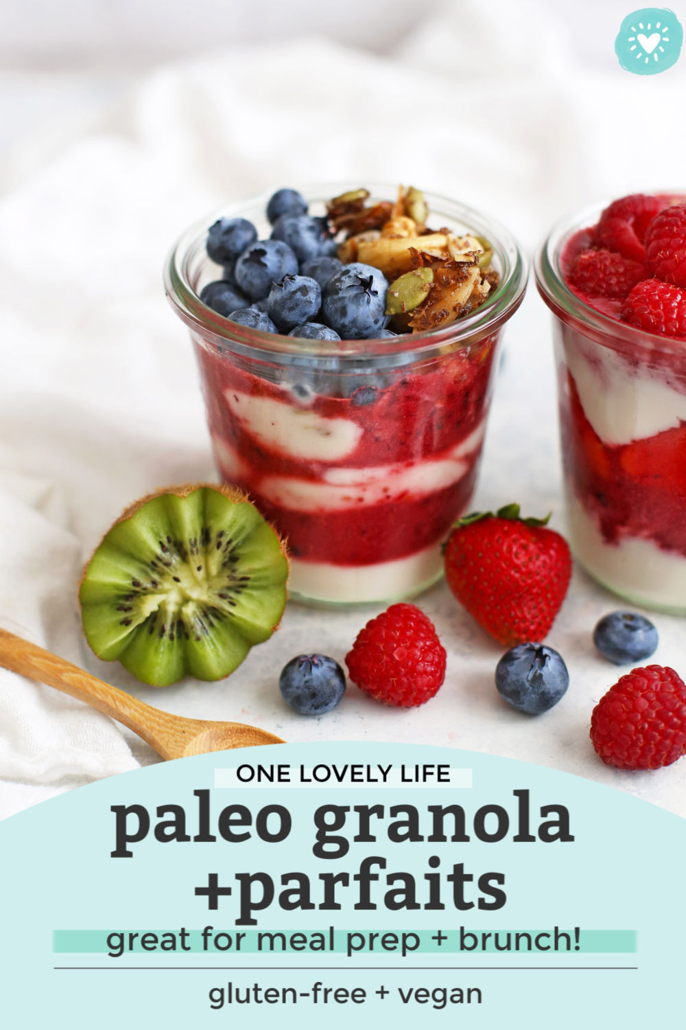 "Front view of jars of paleo granola parfait with fresh fruit, yogurt, and berry puree with text overlay that reads ""One Lovely Life. Paleo Granola + Parfaits--great for meal prep + brunch! Gluten-Free + Vegan."""