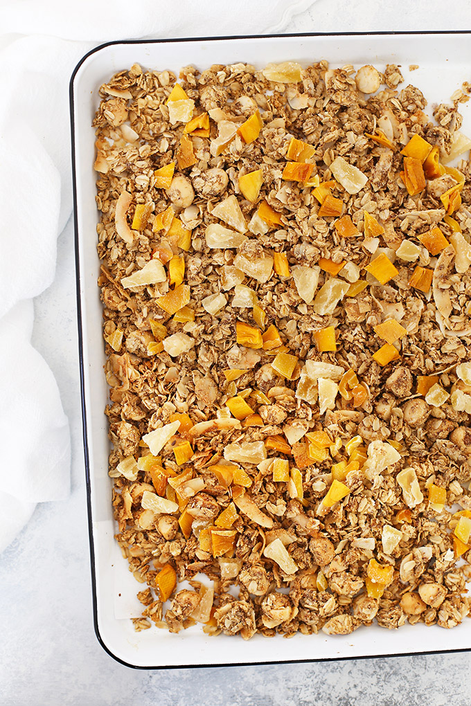 Tropical Coconut Granola with Mango and Pineapple - This Gluten free, vegan granola is INCREDIBLE! Such a good homemade granola recipe!