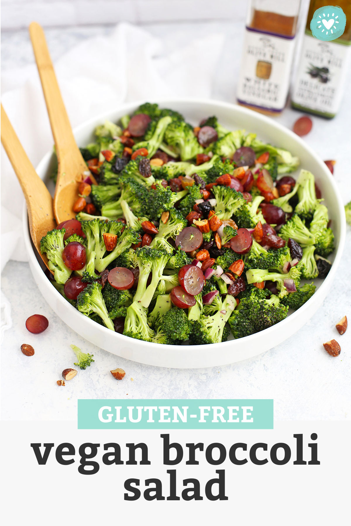 """Front view of Vegan Broccoli Salad with Poppy Seed Vinaigrette in a white bowl with text overlay that reads """"Gluten-Free Vegan Broccoli Salad"""""""