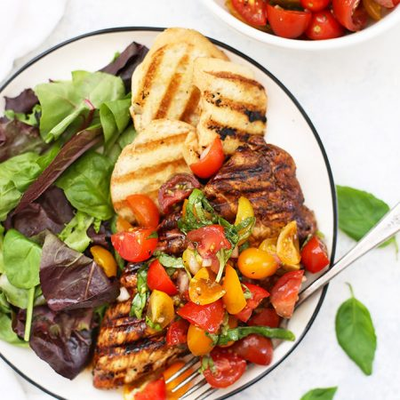 Grilled Bruschetta Chicken - Balsamic marinated chicken with a fresh tomato basil topping. This is SO fresh and delicious! (Paleo & Gluten Free)