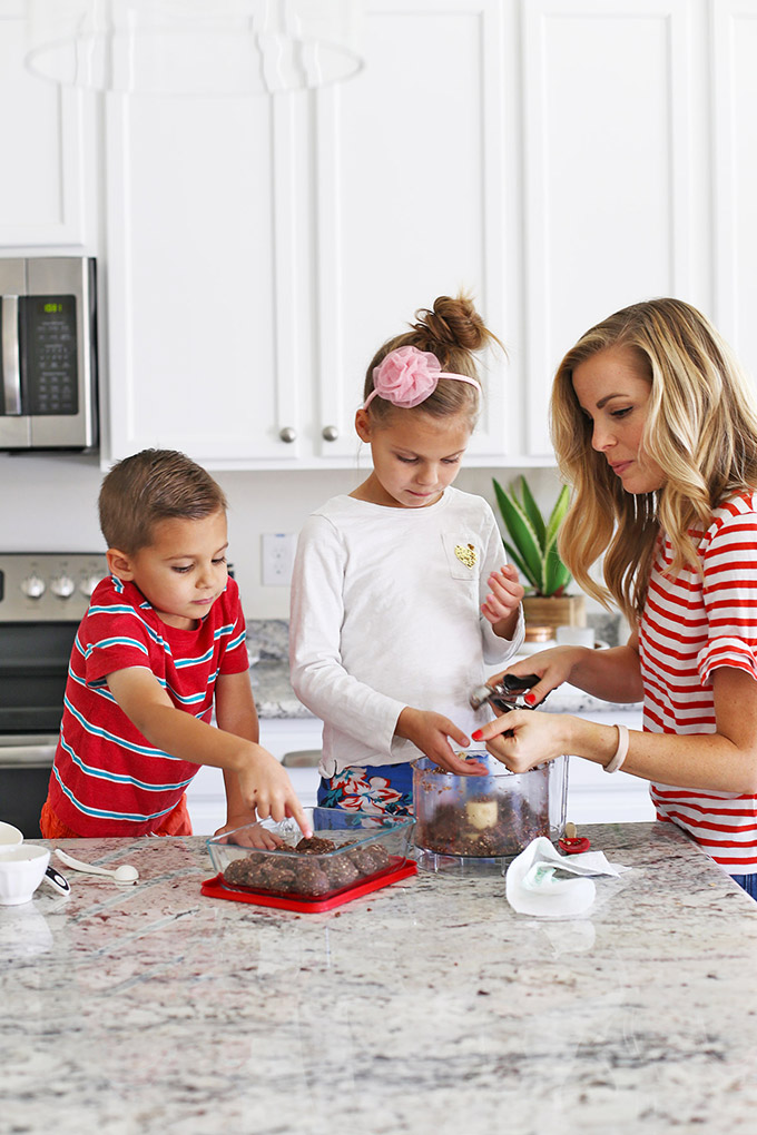 Kids helping mom make energy bites in the kitchen.
