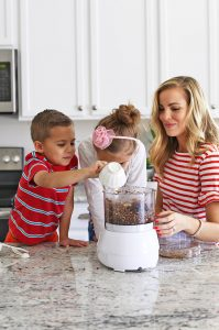 Emily from One Lovely Life in the kitchen with her kids.