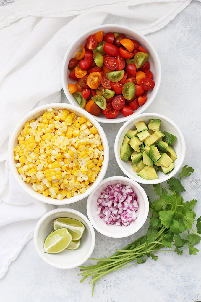 Fresh Corn Salad or Fresh Corn Salsa - Serve it as a side dish or pile this on top of burrito bowls, use it in meal prep, or use as chip dip! Gluten free, vegan // gluten free // dairy free // corn dip // corn salsa // corn salad //