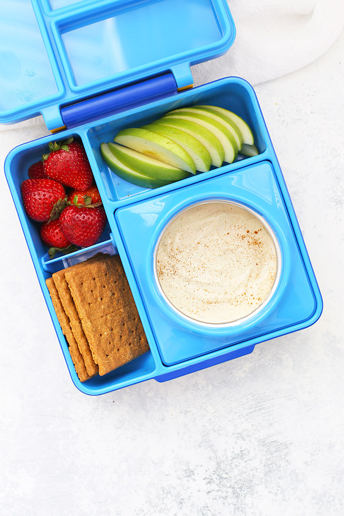 Healthy School Lunch Idea - Dairy Free Fruit Dip, Gluten Free Graham Crackers, Strawberries, and Sliced Apples in an Omie Box lunchbox.