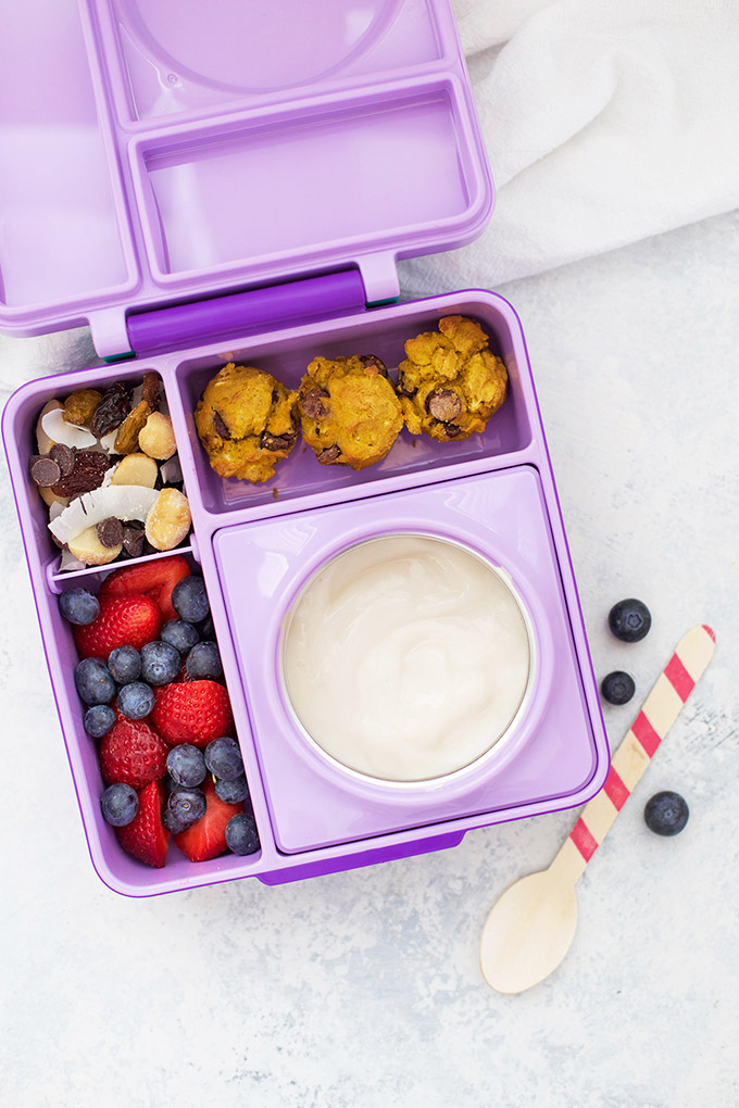 Healthy School Lunch Idea - Dairy Free Yogurt, Gluten Free Pumpkin Chocolate Chip Mini Muffins, Trail Mix, and Mixed Berries in an Omie Box lunchbox.