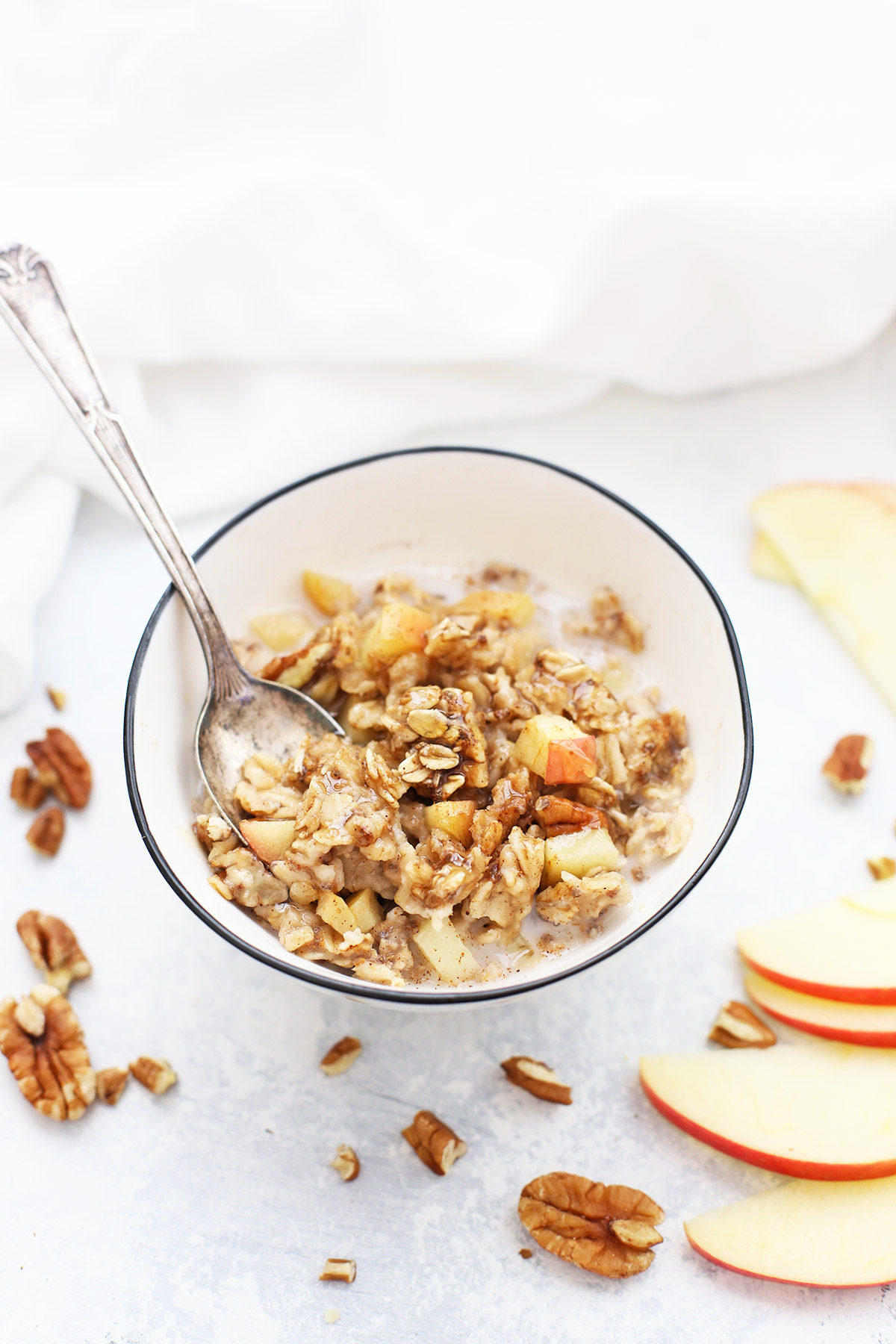A bowl of baked cinnamon apple oatmeal with milk.