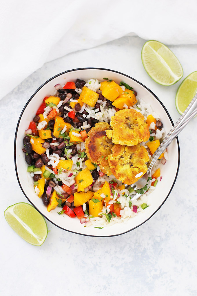 Vegan Plantain Burrito Bowl with Cilantro Lime rice, Cuban Black Beans, Fresh Mango Salsa, and Crispy Plantains mixed together.