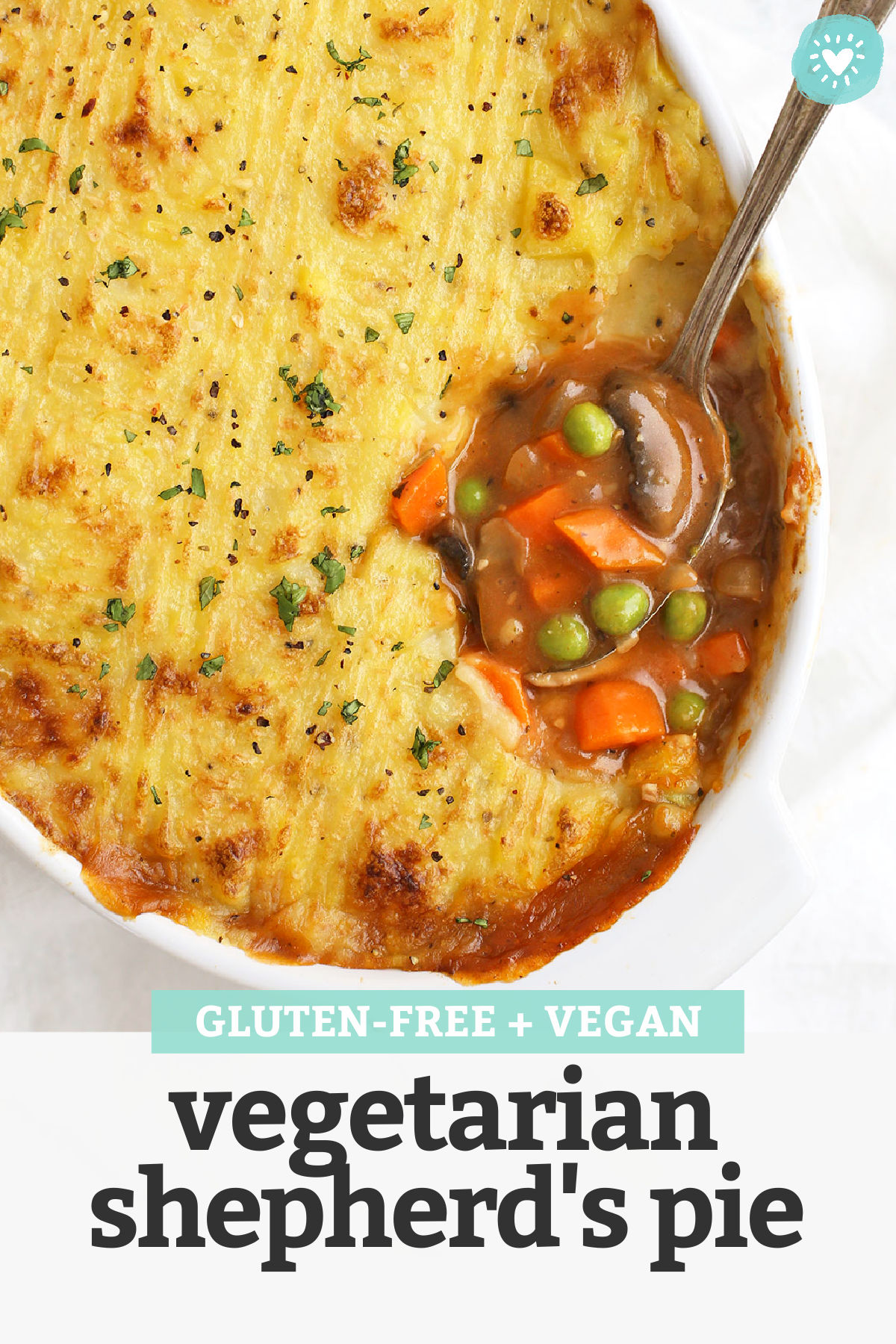 """Close up view of vegetarian shepherd's pie. Spoonful of filling and mashed potato topping with text overlay that reads """"Gluten-Free + Vegan Vegetarian Shepherd's Pie"""""""