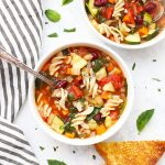 Close up view of two bowls of Vegetable Minestrone Soup.