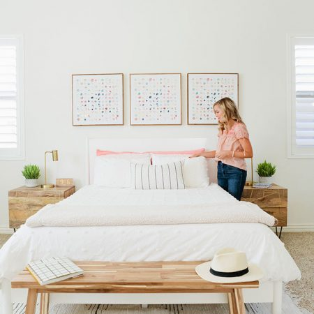 Emily of One Lovely Life styling pillows in her master bedroom, redesigned by Modsy.