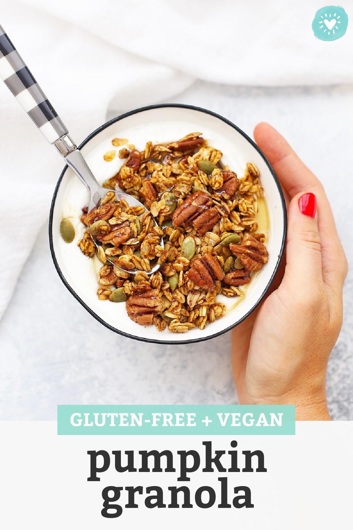 "A bowl of pumpkin granola over vanilla yogurt with text overlay that reads ""Gluten-Free + Vegan Pumpkin Granola"""