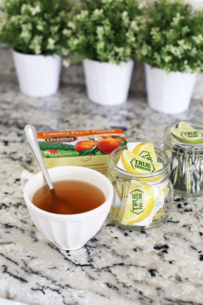 Ingredients for peach herbal tea - Celestial Seasonings Country Peach Passion herbal tea, True Lemon and True Lime packets.