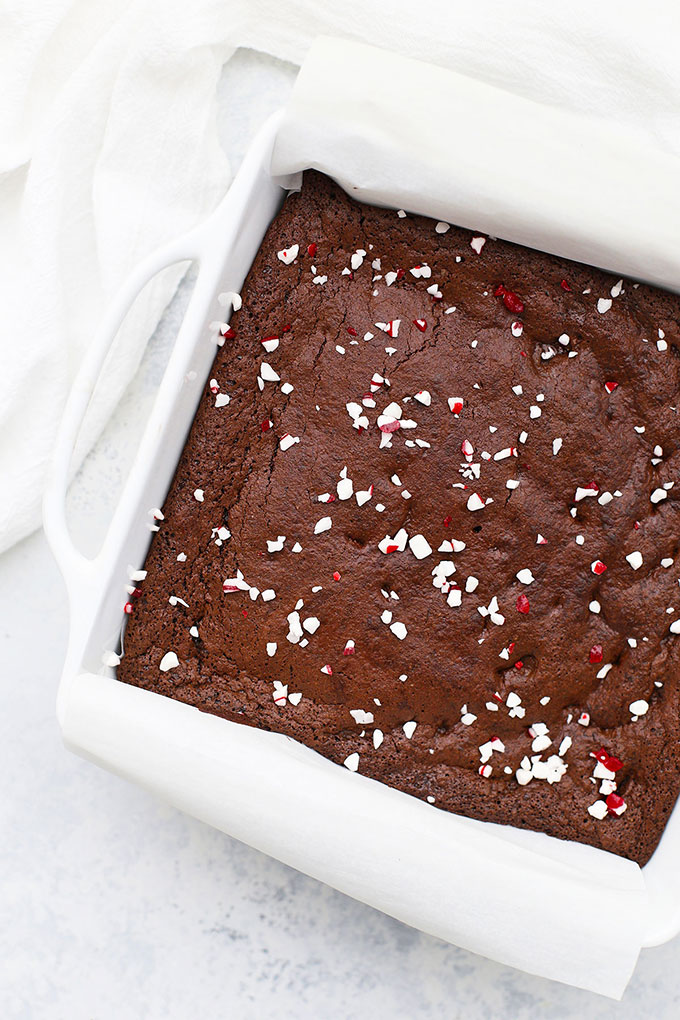 Overhead view of gluten free & paleo peppermint brownies in a white baking dish.