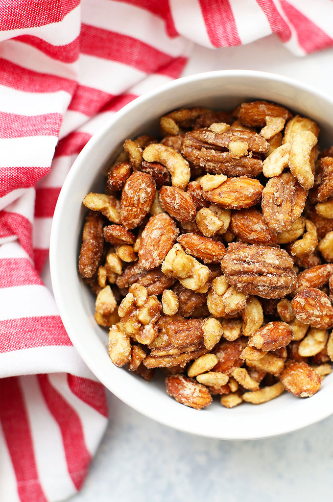 Close up Overhead view of a bowl of vegan spiced candied nuts.