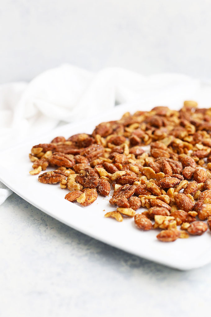 Front view of spiced candied nuts cooling on a baking sheet.