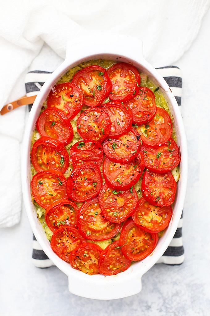 Oval baking dish of Pesto Chicken Spaghetti Squash (Gluten Free, Paleo & Whole30)