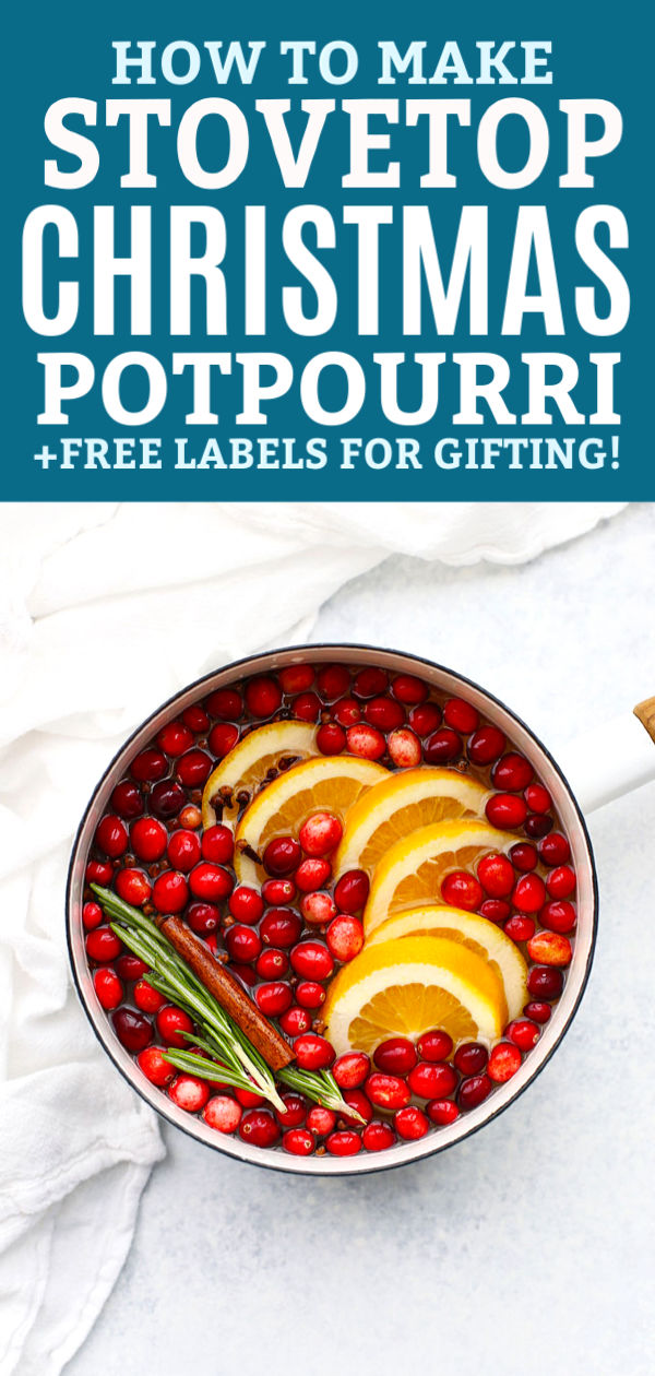 "Christmas potpourri in a white saucepan with water with text that reads ""How to Make Christmas Potpourri + Free Labels for Gifting!"""