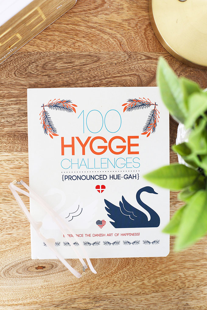 "Book ""100 Hygge Challenges"" on Emily of OneLovelyLife.com's nightstand"