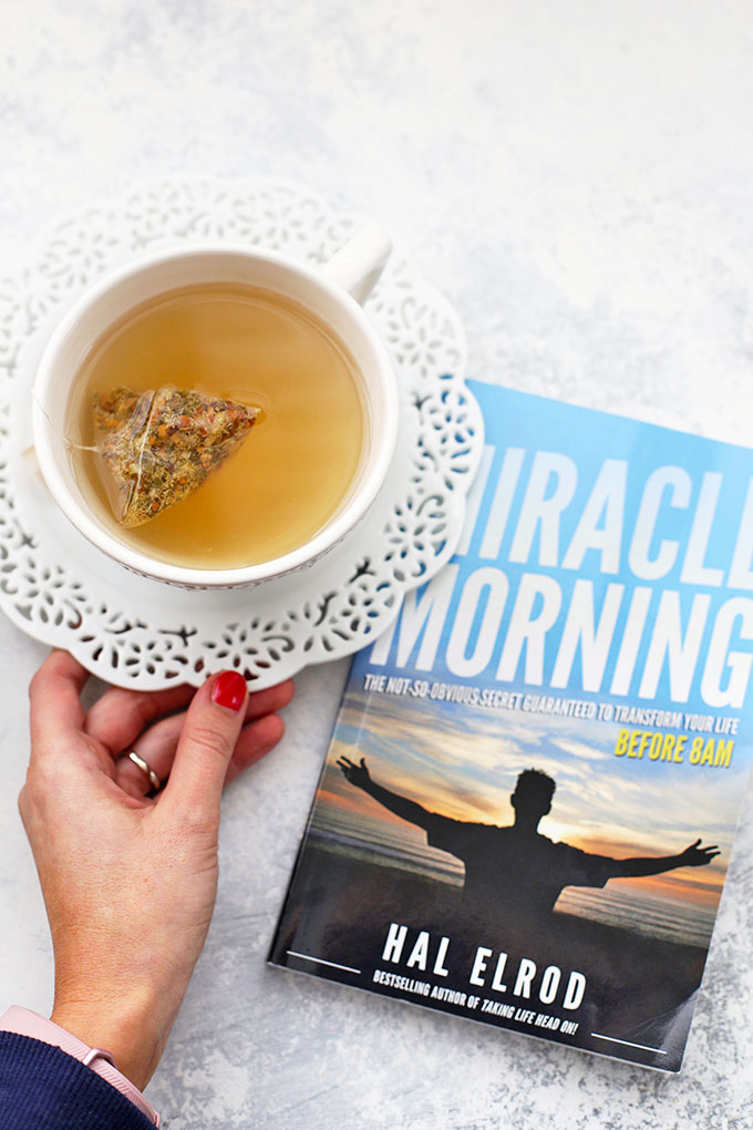 Photo of the book Miracle Morning and a cup of peach tea from OneLovelyLife.com