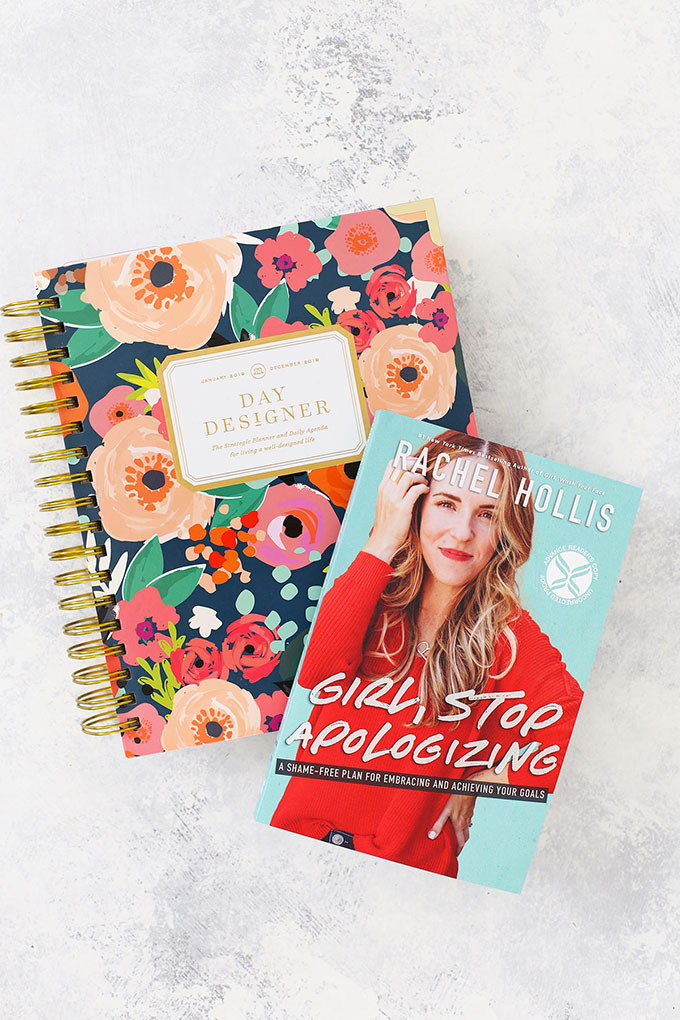 "Day Designer Planner and ""Girl, Stop Apologizing"" by Rachel Hollis"