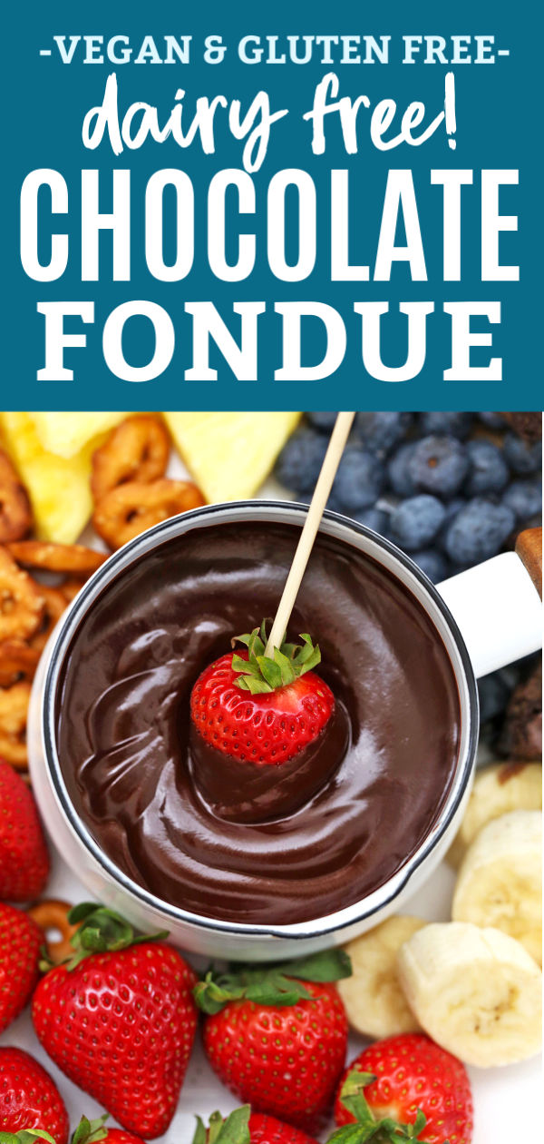 Strawberry being dipped into vegan chocolate fondue from OneLovelyLife.com