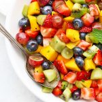 Close up view of Rainbow Fruit Salad with Citrus Mint Dressing from One Lovely Life