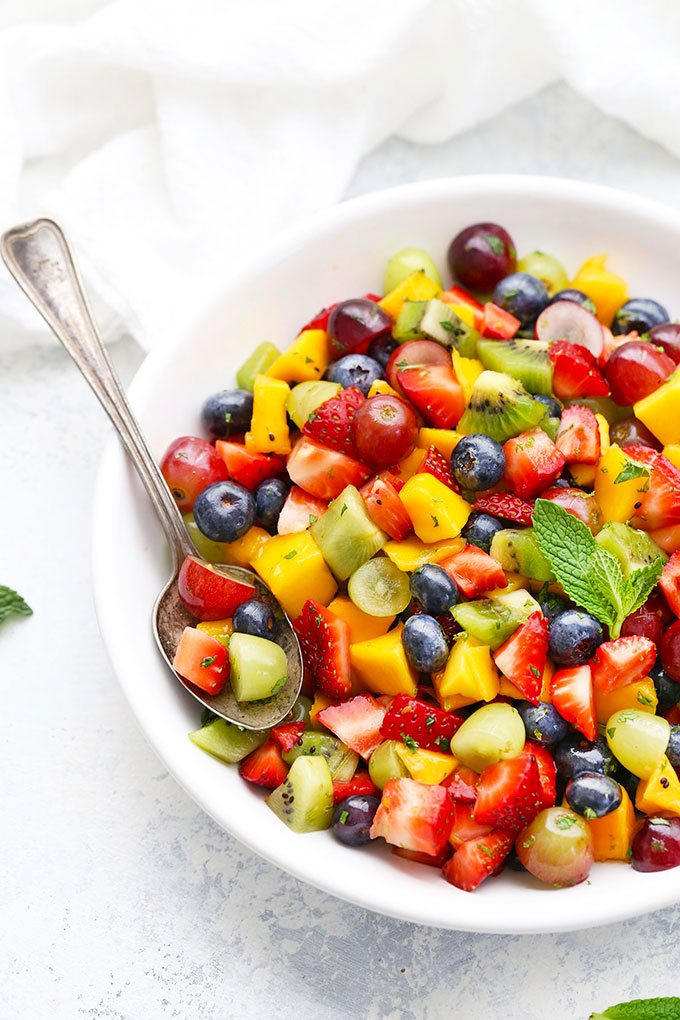 Bowl of Rainbow Fruit Salad with Citrus Mint Dressing from One Lovely Life