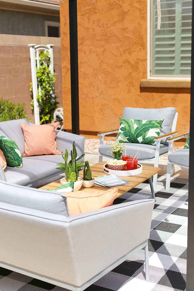 Outdoor living space with Article outdoor furniture from the Garden Scandi collection. Styled with pink and green accessories.
