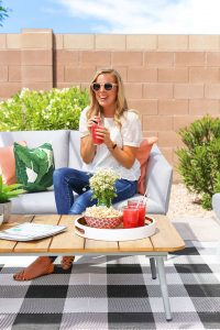 Emily from One Lovely Life sitting on a Palo Paloma Gray Outdoor Sofa from Article.