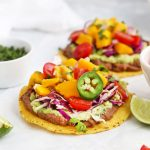 Black Bean Tostadas topped with Cilantro Slaw and Mango Salsa from One Lovely Life