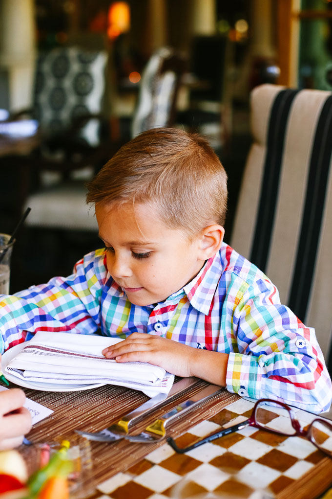 Boy Coloring a Kids Menu at Prado Restaurant at Omni Resort and Spa at Montelucia in Scottsdale, Arizona