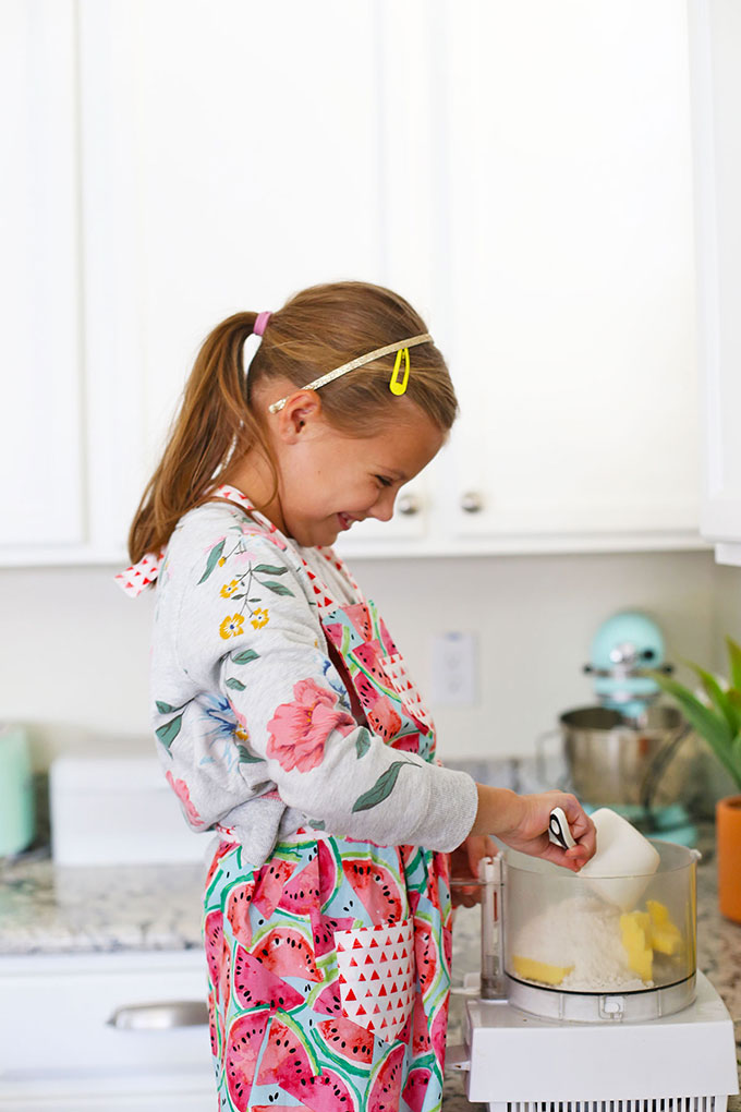 Child mixing up sugar cookie crust for Raddish Kids Cooking Subscription