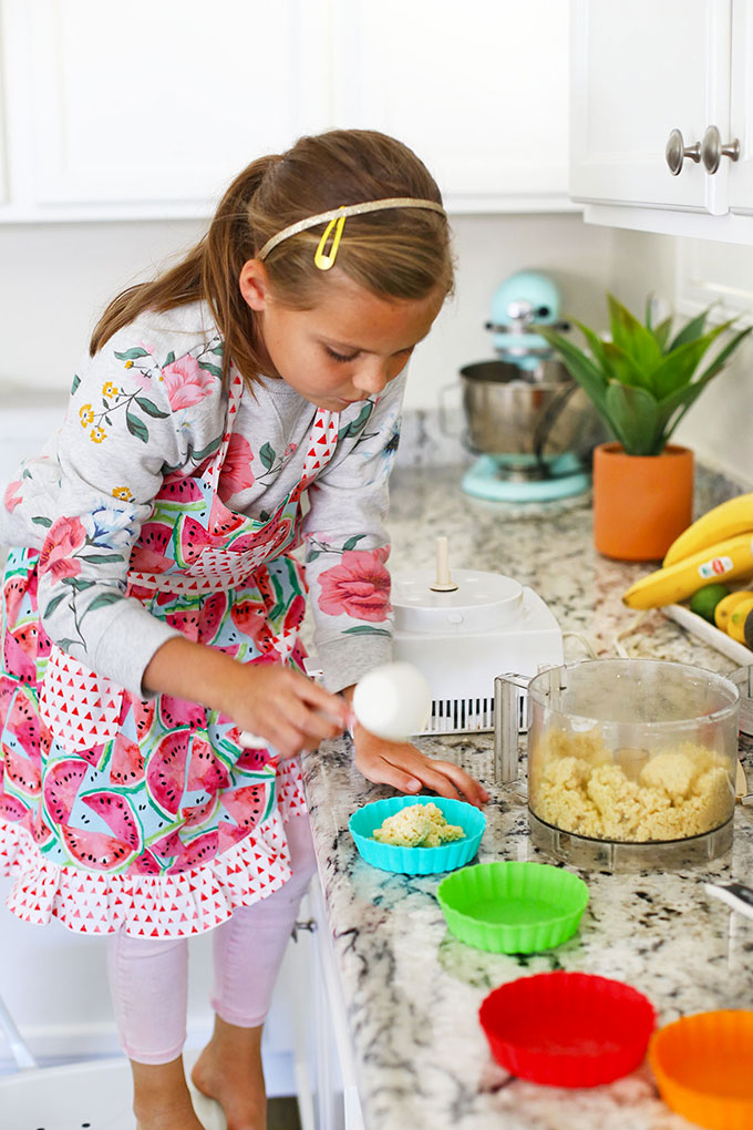 Little Girl Making Rainbow Fruit Tarts with a Reddish Kids Recipe