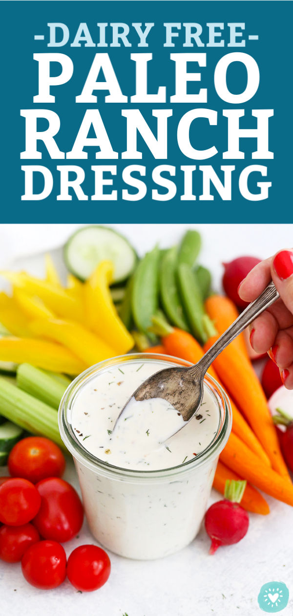 "Spoon scooping dairy free paleo ranch dressing with fresh veggies in the background with text that reads ""Dairy Free Paleo Ranch Dressing"""