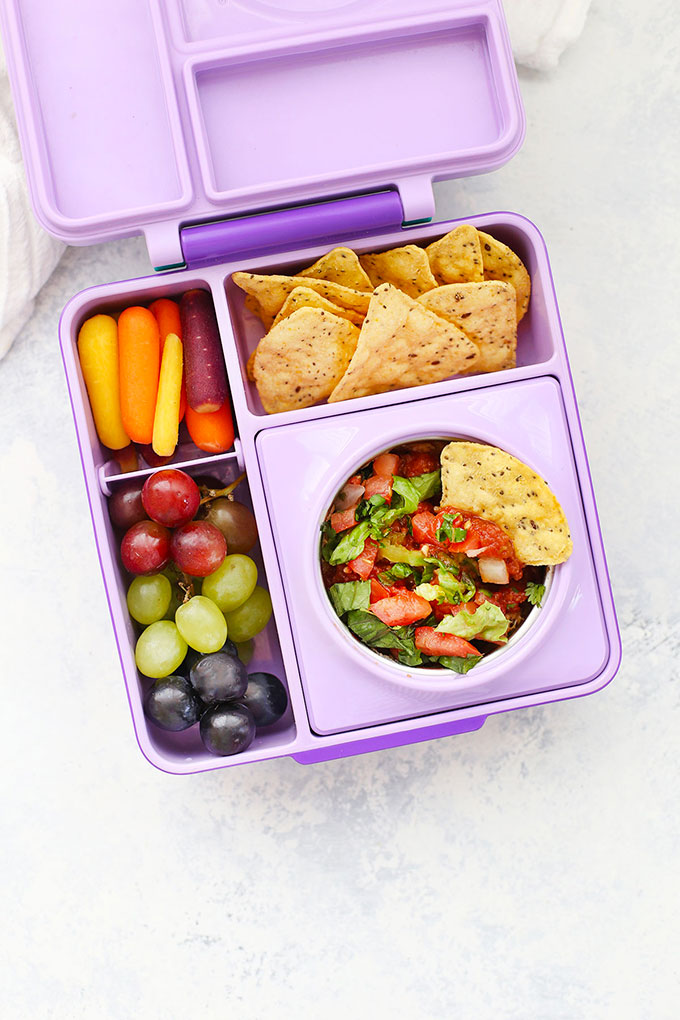 Gluten Free Vegan Bean Dip School Lunch with Tortilla Chips, Grapes, and Rainbow Baby Carrots from One Lovely Life