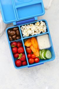 Gluten Free Dairy Free School Lunch with Dairy Free Ranch, Fresh Veggies, Popcorn, Strawberries, and Chocolate Covered Almonds