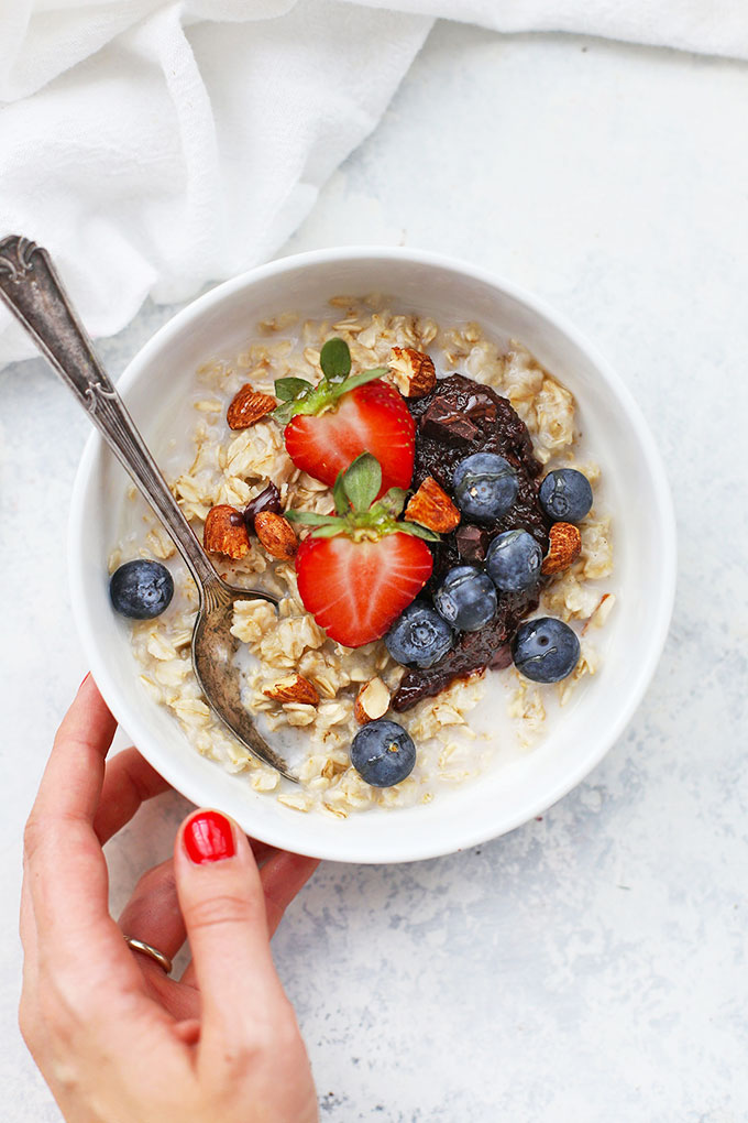 Gluten Free Oatmeal with Chocolate Almond Butter and Fresh Berries from One Lovely Life